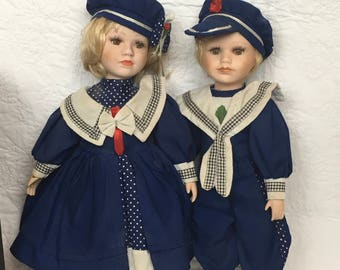A Pair Of Beautiful Antique Porcelain French Dolls