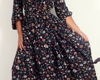 Long black dress of colorful flowers