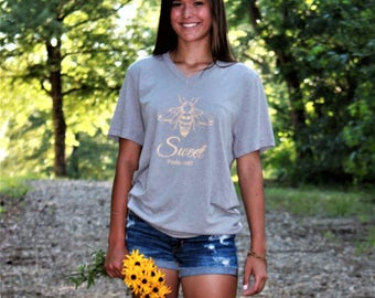 SWEET heathered light gray v-neck tee with golden yellow vintage-style bee graphic