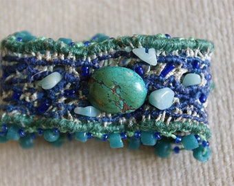 Decorated with a genuine turquoise YAMUNA textile art Cuff Bracelet
