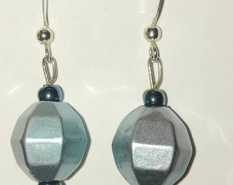 Silver disco ball shape with dark teal beads.