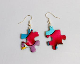 Pieces of puzzle patterned earrings