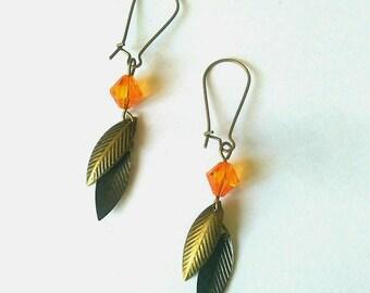 Bronze earring orange tassel.
