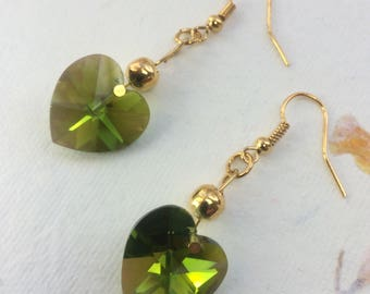 Gold plated drop earrings with large green sparkly Swarovski hearts