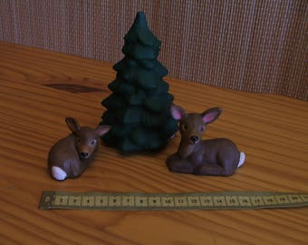 Two small deer with fir tree
