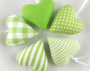 5 heart of fabric stitched in green
