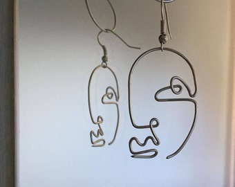 Abstract wire face earrings