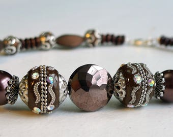 16in. Glass, metal, and wood Beaded Necklace, brown and silver