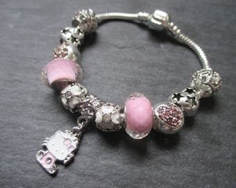Hello Kitty, Cute, Pink and Silver Pandora Style Charm Bracelet with a mixture of silver, glass and enamel charms