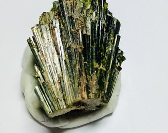 Epidote Crystal, Rich Olive color and nice terminations.  This Epidote was mined from a Scarn near the abandoned mining town of Farland, MT.