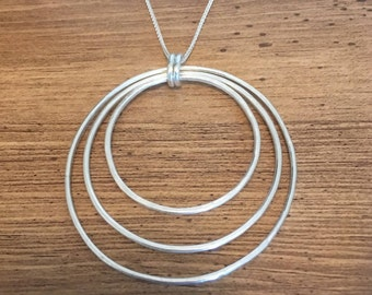 Large silver circles pendant on silver spiga chain