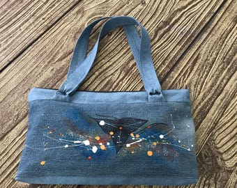 Hand-sewn bag painted with fabric and acrylic colors