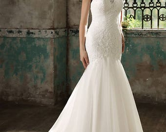 Mermaid sleeveless sheer back gown with appliques