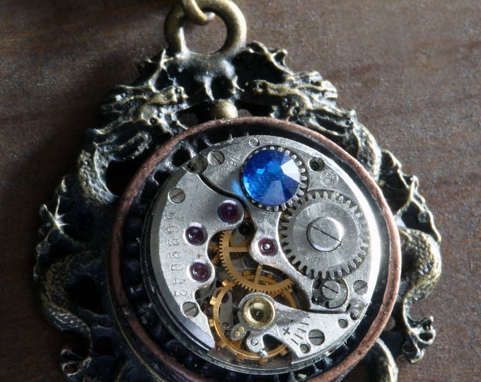 Steampunk necklace with dragon, Antique watch movement and blue crystal