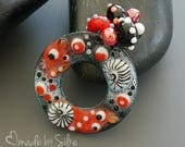 Handmade torch fired enameled component |  donut shaped charm  | pendant   |  made by Silke Buechler