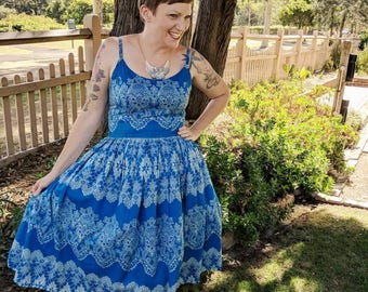 Blue fifties vintage style strappy tea dress. Stunning lace look print frock with gathered skirt