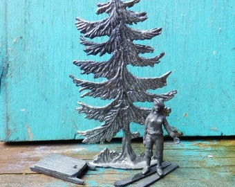 Vintage miniature lead tree and snow skier w/ sled pine tree girl skiing art craft supplies decor