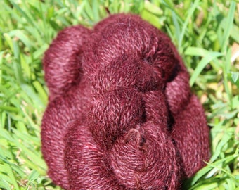 A Hint of Red Overdyed 100% Suri Yarn