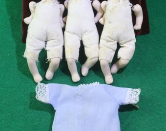 Vintage  Triplets (3) miniature hand painted Bisque and cloth dolls with handmade miniature laced trim smock.