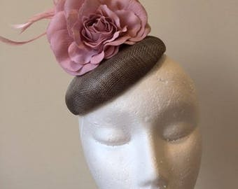 Grey fascinator with 2 pink flowers and feathers. Stunning on