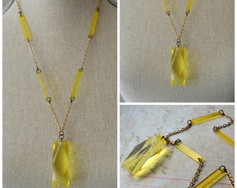 Yellow lucite long flapper style necklace.