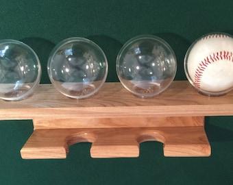 2 bat vertical baseball bat display rack for regular bats (youth up to adult size bats) holds softball bats too.  With a 4 baseball shelf