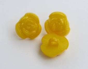 Dark yellow button shaped flower