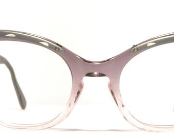 Vintage eyewear. Cat eye style. Made in USA 1960's. Stunning artistic detailing on front and sides. Aluminum brow and sides. Excellent!