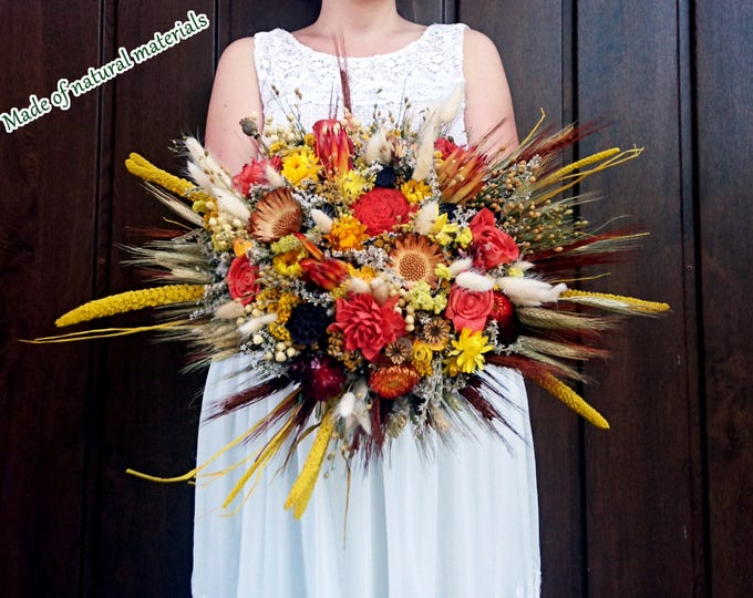Fall wedding bouquet made of dried flowers and wheat