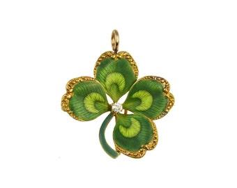 Antique diamond pendant. Krementz four leaf clover pendant / brooch with green enamel decoration, American circa 1900.