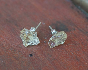Awesome rough and uncut pale citrine earrings made of sterling silver plated posts and includes 925 stamped backs. Wonderful pieces.