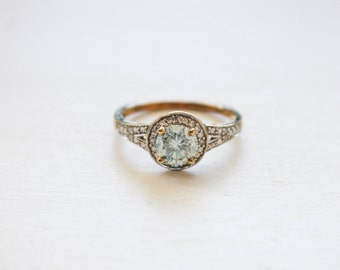 5.97mm Ice Blue Moissanite in Bead-Set Illusion Halo Ring with 8 Natural Diamonds