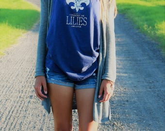 CONSIDER THE LILIES navy crew-neck vintage-style tee with cream fleur-de-lis graphic