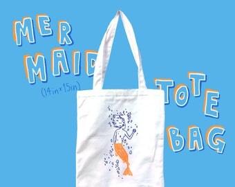 Mermaid Holding Apple tote bag