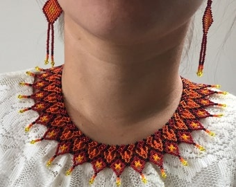Orange beaded bib necklace and earrings