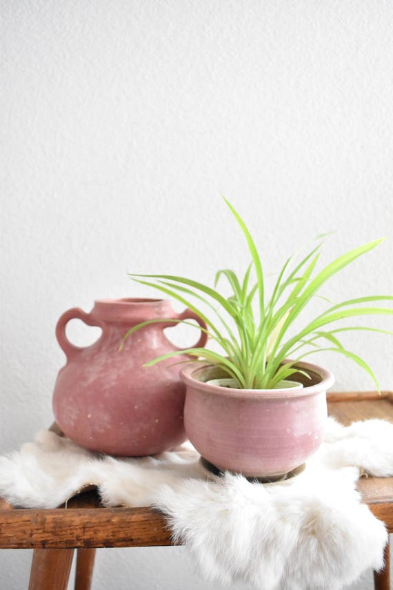 small pink stoneware ceramic flower pot planter with water drainage hole
