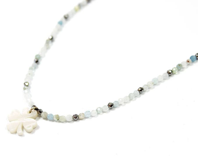 with a clover and the aquamarine necklace