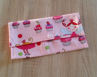 "Clutch is customizable to hold his towel canteen ""Fairies and cupcakes""."