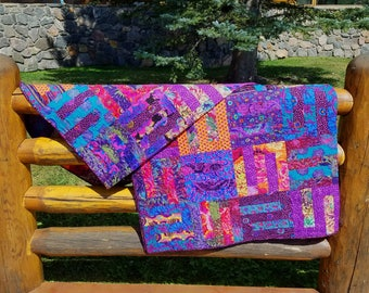 DRAMA QUEEN!  Another Kaffe Fassett inspired quilt with a dynamic combination of intense warm and cool colors--screaming for attention.