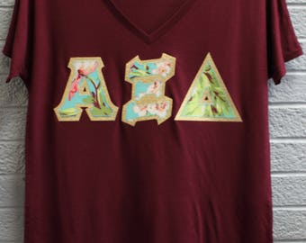 Alpha Xi Delta Maroon Bella Flowy V-Neck With Amy Butler Bliss Bouquet on Gold Metallic (254C)