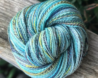 Handspun yarn, turquoise, blue, yellow, pink, ice blue, and purple tones, 100% merino wool, malabrigo wool,  sport weight, three ply