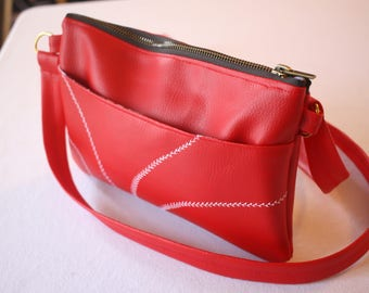 Red faux leather embroidered pouch