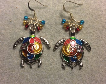 Large colorful enamel sea turtle earrings adorned with tiny dangling dark red, amber and turquoise Czech glass beads.