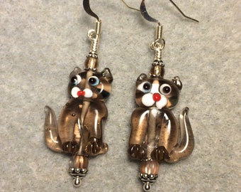 Translucent tan lampwork cat bead earrings adorned with tan Czech glass beads.