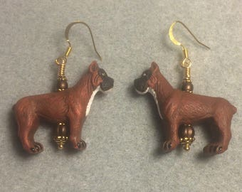 Brown, black, and white ceramic boxer dog bead earrings adorned with brown Czech glass beads.