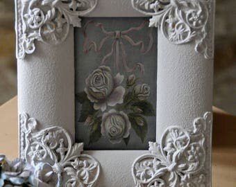 Old picture in wood with metal ornaments.