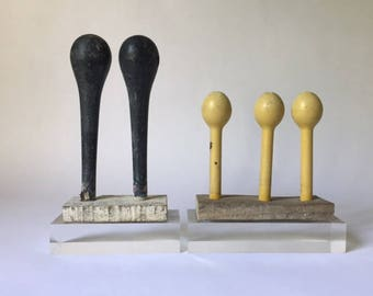 vintage balloon molds with old painted wooden bases, mounted on lucite for a fresh modern folk art found object look, pair