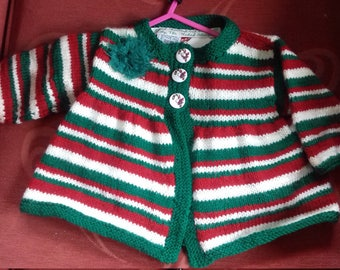 Hand knitted Christmas cardigan for a child aged 3-6 months