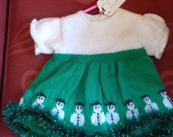 Hand knitted Christmas themed dress to fit a baby girl aged 6-12 months old