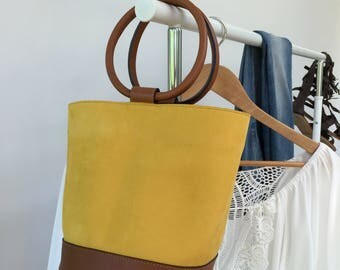 Summer Sale 20% off.  Little bucket bag with round top handles. Summer bag in smooth yellow suede and handles in caramel colour leather.